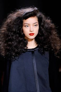 WAYS TO WEAR CURLY HAIR NOW: TEASED SPIRALS - The Look: With the beachy waves we've been seeing on the catwalks for many seasons now, this billowing style at Marc by Marc Jacobs set a new standard for curly hair.