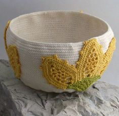 Crochet bowl embellished with flower appliques from Nothingbutstring.