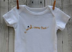 A personal favorite from my Etsy shop https://www.etsy.com/listing/251095856/cute-baby-onesie-w-a-wish-come-true-in