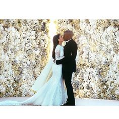 Pin for Later: Proof That Kim's Been Making Kanye Smile Since 2012 December 2014 Kim and Kanye's wedding snap was declared the most liked Instagram post of the entire year, with over 2.4 million likes.