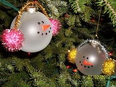 snowman ornaments BUT do it yourself / CRAFT WITH KIDS with generic white plastic christmas ball ornaments, some tinsel and pipe cleaners and cut out stickers for eyes and mouth and nose.