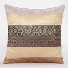 2 of these against bright white pillows and a white duvet. Just need a bright throw over the corner of the bed @ WorldMarket.com: Multicolored Sari Miramar Lumbar Pillow
