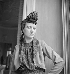 Madame Rioteau wearing an amazing spiral tied hat. 1941. Unknown milliner. Photo by Roger Parry. French Photographic Archives.