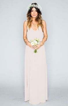 Pick a bridesmaid dress in a neutral color + simple silhouette to play up your ladies' natural beauty.