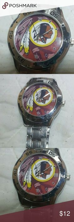Wasinginton Redskins Logo Stainless Steel Watch Wasinginton Redskins NFL Logo Stainless Steel Watch NEW  High Quality Quartz Movement: provide precise and accurate time keeping.  Case Diameter :4.10 Centimeter ;Band Width : 1.90 Centimeter.  Double Locking Fold Over Clasp.  Waterproof For Daily Use: Perfect for all kind of business, casual, indoor activities or daily use.  NOTE:In general, withstands splashes or brief immersion in water, but not suitable for swimming. NFL Accessories Watches