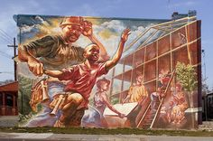 Mural: 'A Message to the Child...The Hero Can be Found' Artist: John Lewis Philadelphia's Mural Arts Program evolved from a simple 1984 project organized by muralist Jane Golden to combat the city's graffiti problem.