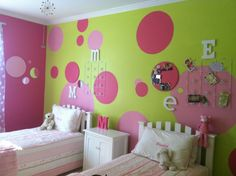 This is how we redecorated the girls' room-bright pink and green, then I found round cork boards which we painted and finally we added round mirrors for a poka dot room!