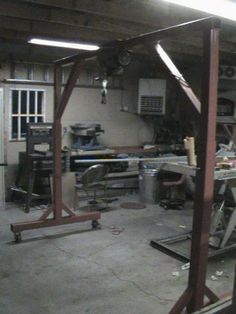 Gantry Crane by Hephaestus29 -- Homemade gantry crane powered by an electric hoist. Fabricated from 4x4 steel tubing and incorporating heavy-duty casters for enhanced mobility. http://www.homemadetools.net/homemade-gantry-crane-2