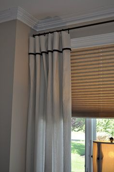 Drop cloth curtains with trim, remember you can use a hot glue for the trim!
