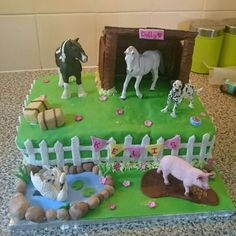 Horse stable birthday cake with a pig and pond with swans