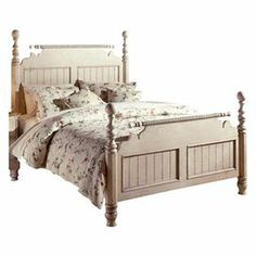 Turned bed with antiqued New Zealand pine accents and a hand-rubbed finish. Includes matching rails. Product: BedConstruction Material: New Zealand pineColor: Antique white