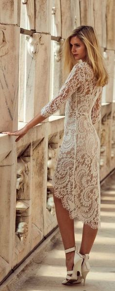 white crochet needle dress. wouldn't wear it, but I love the high low