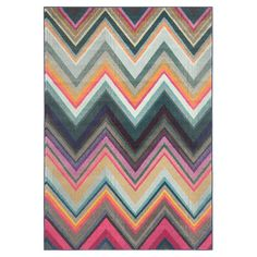 Anchor your living room seating group or define space in the den with this loomed rug, featuring a multicolor chevron motif for eye-catching appeal....