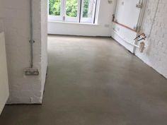 This microcement floor in Derby is a beautiful example of what can be achieved with just 4mm of concrete overlay. CARRcrete PROtop Loft