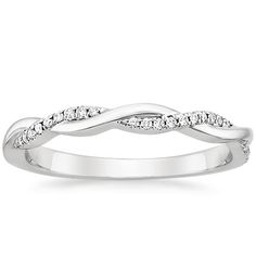 Ribbons of pavé set diamonds and dazzling white gold appear gracefully woven together in this nature-inspired design.