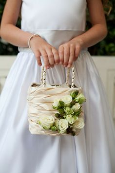 This is the idea for the flower girls' baskets. I am going to cut the blue satin in strips and braid it and then make blue flowers with the sheer with white fabric roses!