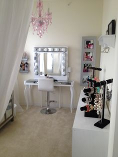 Pink silver white glam hollywood makeup vanity room chic sheer white curtains chandelier