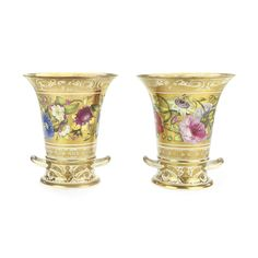 A pair of Derby flower vases and two-handled stands circa 1815 of flared form, each well painted with a frieze of garden flowers on a solid gilt band, the circular stands gilt with foliate scrolls Quantity: 4