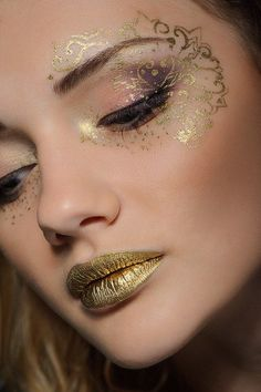 Fantasy Make-up- Stencil eye make up and golden lips creates a ethereal effect to this look. #fantasymakeup #goldengirl
