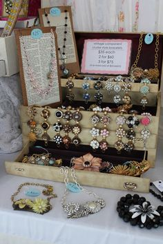 Love the old, old jewelry box display with antique jewelry
