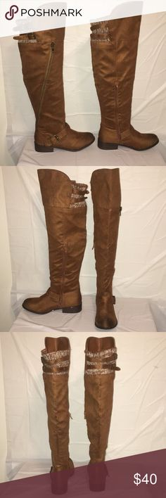 Knee high riding boots Brown suede knee high boots. For me they reach just above the knees, with a zipper along the inside of the calf. Just behind the knee is wool material and buckles overtop to adjust the fit around the knee. Designer Shoe Warehouse Shoes Over the Knee Boots