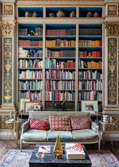 There's just something about a nod to Old World libraries that feels new again. From the ornate gold detailing to the plush velvet sofa to the kilim pillows, the texture in this home library...
