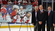 NEWARK, NJ - DECEMBER 07: Former New Jersey Devils captain Scott Steven (C) is presented a painting honoring his induction into the Hall of Fame from Jeff Vanderbeek, chairman and managing partner, (L) and Mike Gilfillan, vice chairman of Devils renaissance developement, before their game against the Washington Capitals at the Prudential Center December 7, t 2007 in Newark, New Jersey. (Photo by Jim McIsaac/Getty Images)