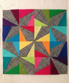 "Yummy, yummy ""Wonky Pinwheel"" block by Maureen Kelly. Love the brights against this grey background."
