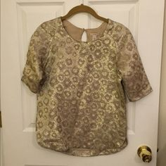 J. Crew Metallic Gold Top Size 0 A RePosh, purchased this and it doesn't fit me. In good used condition and doesn't have any flaws. Smoke free home. Will consider bundles, let me know if you're interested. Please do not submit lowball offers and do not ask my lowest- it's rude. :) Feel free to submit all reasonable offers! No trades. J. Crew Tops Blouses
