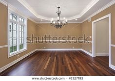 Dining room in new construction home with tan walls by pics721, via ShutterStock