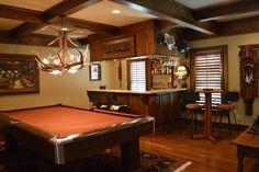Billard room/Gentlemen's room with bar that includes a wet ice machine, wine cooler, bar ware racks and smoke ventilation.
