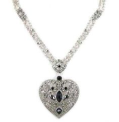 Project an air of old world allure with this captivating 3 inch heart pendant necklace. The ornate silver plated heart is accented with marcasite and black crystal stones, the vine-like filigree design of the silver plated backing sets off the stones in old world design.  This intriguing pendant is perfectly complemented by a thick and brightly polished double cable 18 inch silver plated chain, with 2 inch extender secured by a lobster claw clasp...