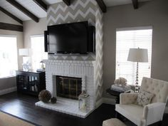 love how the chevron takes the place of art above the fireplace.