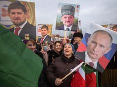 Chechen leader Ramzan Kadyrov (poster in top left) is a staunch supporter of Russian President Vladimir Putin, but both men have been criticized by human rights groups. Tens of thousands of people took part in a state-sponsored rally in Chechnya's capital Grozny on Jan. 22, with many holding posters of Kadyrov, Putin (right) and Kadyrov's late father, Akhmad Kadyrov (center).