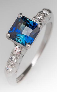 Stunning blue-green sapphire and diamond ring