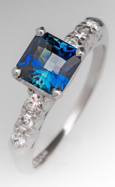 Stunning blue-green sapphire and diamond ring