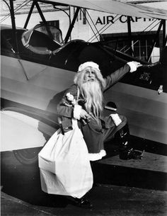 Santa Claus climbing into a Stearman airplane at hangar at Wichita Municipal Airport in city's southeast section. 1929  http://www.wichitaphotos.org/graphics/wsu_ms2002-12.67.10.4.jpg