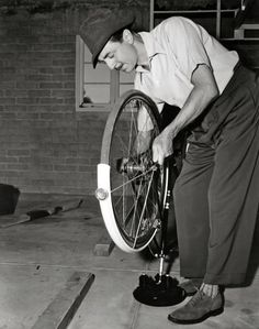 William Powell fixes a bike.  Tags: William Powell MGM 1942