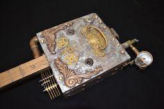Steampunk cigar box guitar