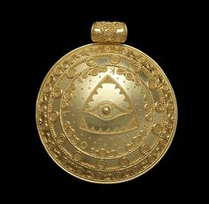 "Akelo Andrea Cagnetti - PRIJIPATI (pendant). A gold round domed ""bulla"" pendant, the surface decorated with geometric and phytomorphic motifs, with an ""eye all seeing"" to the centre, rendered using filigree and granulation, embellished with ""fine dust"" granulation, to a similarly decorated horizontal cylinder pendant loop."