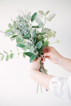 Throwing A Party? These 3 Flower DIYs Will Take Your Soiree To The Next Level  #refinery29  http://www.refinery29.com/floral-arrangements#slide-4  2. Start by grouping a central mix of your green foliage together. Hold the flowers in the hand you don't write with. Use the hand that you do write with to assemble the bouquet. It is your strongest hand and you will need your most dexterous hand to assemble the bouquet. ...