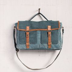 """The Ashton Messenger Bag makes the perfect bag for busy people on the go who value functionality and style. Featuresleather and antiqued metal accents with a long 24"""" adjustable strap with 11"""" handle drop, a back zipped pocket and two front pockets. Measures15"""" W x 12"""" H x 3.5"""" D Waste not, is the concept behind these awesome bags from Mona B. Why make new materials when there are interesting and perfectly usable fabrics that can be recycled or upcycled. Mona B'..."""