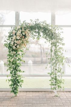 Greenery wedding ceremony arch - greenery-covered trellis with white flowers - garden #wedding decor {Blossom and Vine}