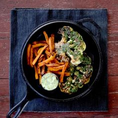 Cauliflower steaks roasted in a classic chimichurri and served up with sweet potato fries and vegan aioli.