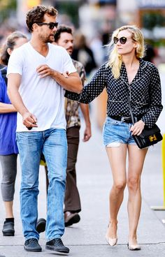 Diane Kruger paired her shorts with a billowy blouse to dress up her shorts // #CelebrityStyle