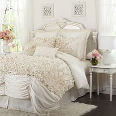 @Overstock - This bedding is made from ivory colored faux silk and each of the handmade bowties of charmeuse are sewn by hand onto the comforter. The effect of seeing this cascade of bows on this soft fabric is incredible. $169.99. This isn't the sophisticated look I'm going for. But the girly girl in me really likes this comforter and the room as well.