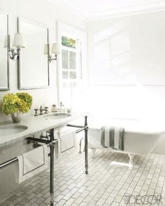 Bath in front of window placement (difficulty opening?); double pedestal basin with towel rail; rectangular mirrors