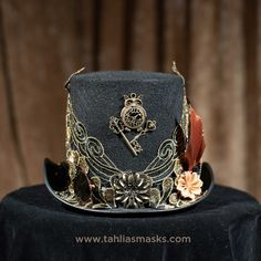Who cares if you don't NEED a #steampunktophat? This one is a work of art. Display it in your house and have it on hand for that special party. One of my favourites. Sheer #steampunk elegance. How would it make you feel if you wore it? #steampunkstyle #handmade #steampunkfashion #cosplay #fashion #accessories #handcrafted#steampunkhats #hats #hatslovers #hatspiration #hatsrule #hatswithsoul #hatsxclusive #hats4sale #exclusivedesign Steampunk Top Hat, Steampunk Fashion, Steampunk Accessories, Fashion Accessories, Half Mask, Cogs, Gold Lace, Cowboy Hats, Feather