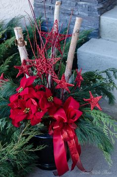 Classic Christmas Red Outdoor Décor Home Tour ~ Beautiful outdoor red Christmas arrangement made with fresh greenery, birch logs, grapevine stars, red poinsettias and a large bow / timewiththea.com