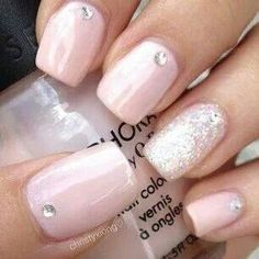 Light Pink Nails with Glitter Accent and Rhinestones